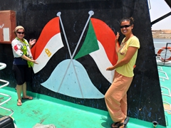 Ally and Becky in front of the Sudan and Egypt flags on board our Wadi Halfa-Aswan Ferry; Lake Nasser