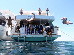 The boys putting on a lunch time show (Luke, Matt, Funny Divers guy, and Robby) perform back flips off the dive boat; Hurgada, Egypt