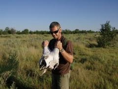 Robby holds up the remains of a giraffe skull; Okavango