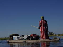 Our cooking equipment is gracefully poled down the Okavango Delta by a statuesque poler