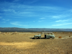 Gutted car remains in the middle of the Sahara desert