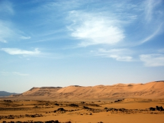 We were surprised to discover that a large majority of the Algerian Sahara is actually not sand dunes but rather the landscape seen here; Tamgs Kis