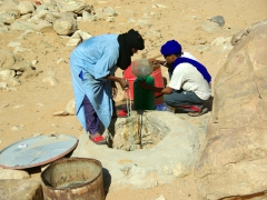 Abdsahlem and Salim drawing water from a deep well near Tamgs Kis
