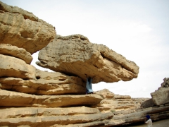 Abdsahlem pretends to balance this precariously balanced rock with his strong arms; Tamgs Kis