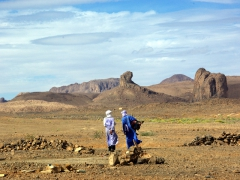Tuaregs chatting as they stroll near their zeriba on the outskirts of Assekrem