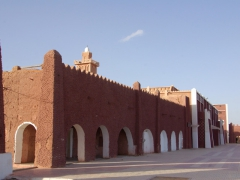 Typical building on the main square of Adrar