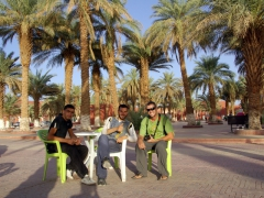 Robby stops and says hello to a couple of friendly local guys; Adrar