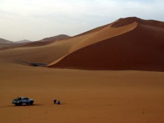 Salim and Abdsahlem preparing our campsite; Mhajeba sand dunes