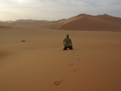 Robby on the top of the sand dunes; Mhajeba