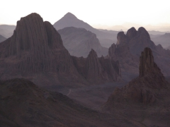 Jagged mountain peaks as far as the eye can see as dawn approaches on Assekrem