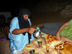 Abdsahlem pours Robby a cup of Tuareg tea; Mhajeba