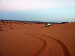 Our driver skillfully drives through the dunes with no problems; Mhajeba