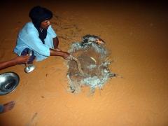 Abdsahlem making taguila; Mhajeba Sand Dunes