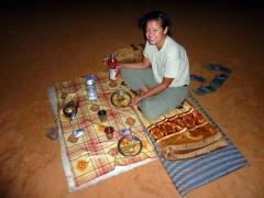 Becky enjoys the local specialty (Taguila) for dinner; Mhajeba