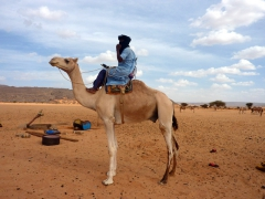 Abdsahlem shows us how the Tuaregs ride a camel; near Tamgs Kis