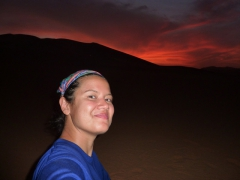 Becky takes a self portrait as the sun sets in Mhajeba