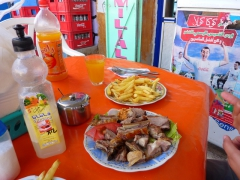 Roasted lamb and fries, one of our favorite dishes in Algeria; Tamanrasset