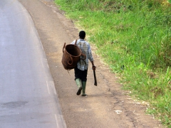 A man armed with his trusty machete and a basket; a common sight in Africa