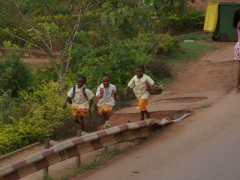 School kids running home after school; Yaounde