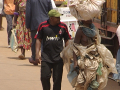 A sack garbed woman strolls the streets of Yaounde