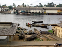 Pirogues line the harbor of Kribi's fish market