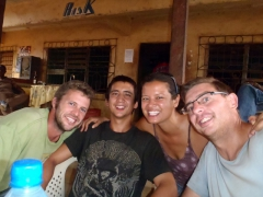 Celebrating with a birthday beer with the boys (and Becky); Ekok border crossing bar