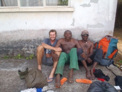 Robby strikes a pose with Francis and another Mt Cameroon porter at the culmination of our 2 day trek