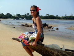 Becky strikes a pose atop a pirogue; Lobe waterfalls