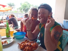 Nancy and Lucky devour their prawn lunch; Kribi fish market