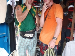 Lucky and Lars contemplate their shopping purchases; Kribi