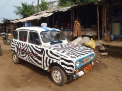Zebra painted car; Kribi market