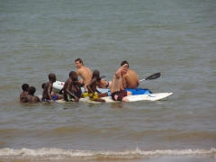"Lars, Hoff and Luke enjoy paddle boarding with local Pointe Noire kids in tow at the ""Le Club Nautique"" at Cercle Naval"