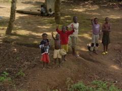 Happy children in Nyanga wave hello