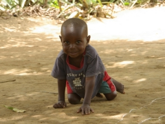 An adorable boy crawls towards us; Nyanga