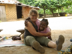 Norma gets a bear hug from the matriarch of the Nyanga family whose house we stopped at
