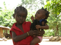 Children in Africa are excellent baby-sitters as they do a fine job caring for their siblings