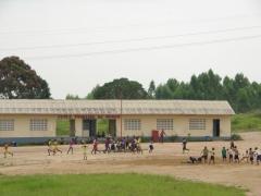School kids exercising on school grounds; near Pointe Noire