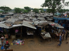 Corrugated tin roof shacks serve as an outdoor market; Pointe Noire