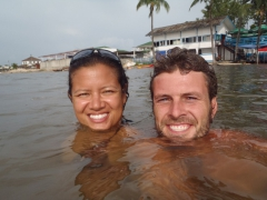 "Smiling as we take a refreshing dip in the ocean at ""Le Club Nautique"""