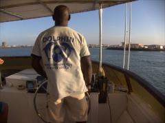 Our Dolphin Excursions captain steering us back into port