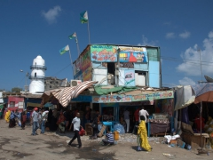 Restaurant shacks with Hamoudi Mosque in the background; Djibouti Central Market