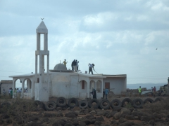 Locals white wash a new mosque, outskirts of Djiboutiville