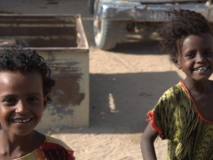 Smiling children greet us on the long, bumpy ride to remote Lac Abbe