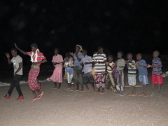 Nomadic Afar boys and men eagerly put on a song and dance show for us that night; Lac Abbe