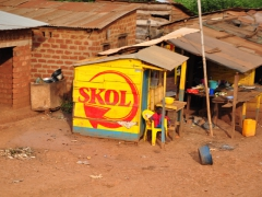 Bright colors on the side of this shack make for effective advertising; Kinzau-Mvuete