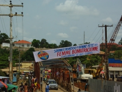 A Primus banner wishing the locals a fantastic Women's Day; Boma