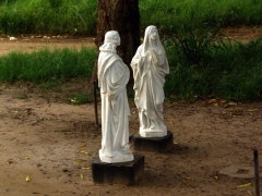 Religious statues on a secondary road in Muanda