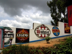 Beer labels on a factory wall; Matadi