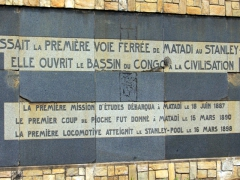 "A wall plaque just outside Matadi commemorating the opening of the Congo to the rest of the world, ""Here passed the first railway from Matadi to Stanley Pool, She opened up the Congo Basin to civilization"""