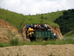 An overloaded truck carries its passengers from Matadi